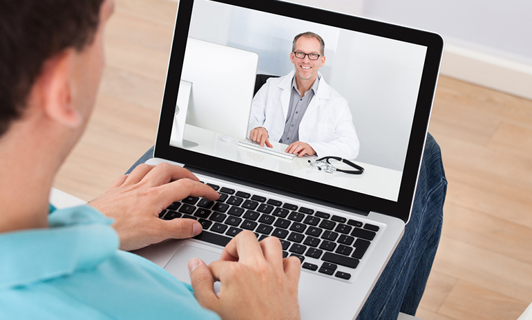 man video chat laptop doctor