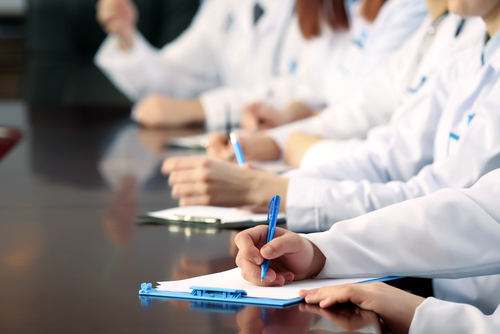 medical workers taking notes
