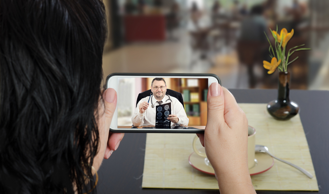 woman mobile video message doctor