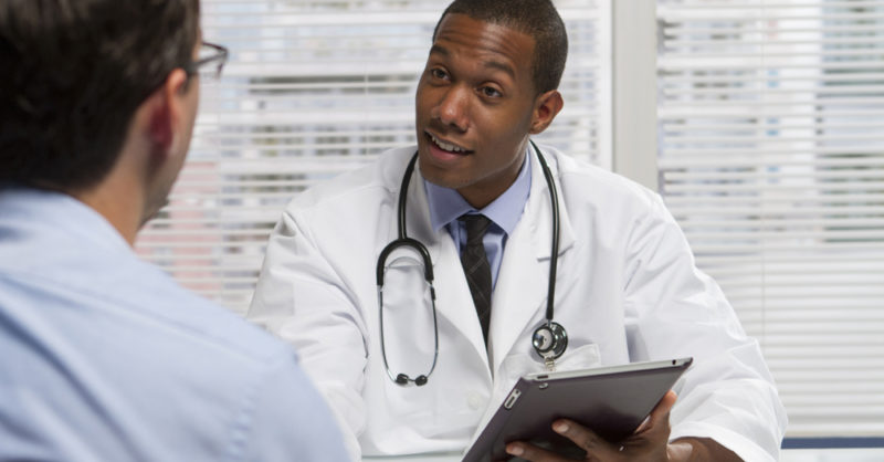 young doctor consulting patient